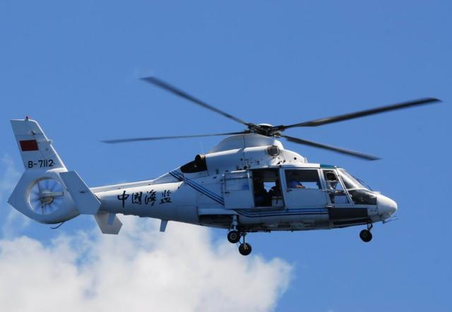 菲律宾青年扬言公布中国直升机巡逻中业岛影音