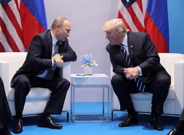 普京 特朗普 给出 回答 信不信/2017年7月7日,在德国汉堡,美国总统特朗普(右)与俄罗斯总统...