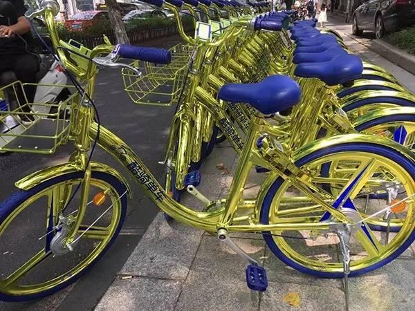杭州/杭州现土豪金单车能够移动充电网友:谁说单车颜色用完了