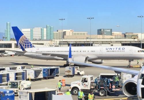 美航空公司为抢客 中国航线旅客可免费托运2件行李