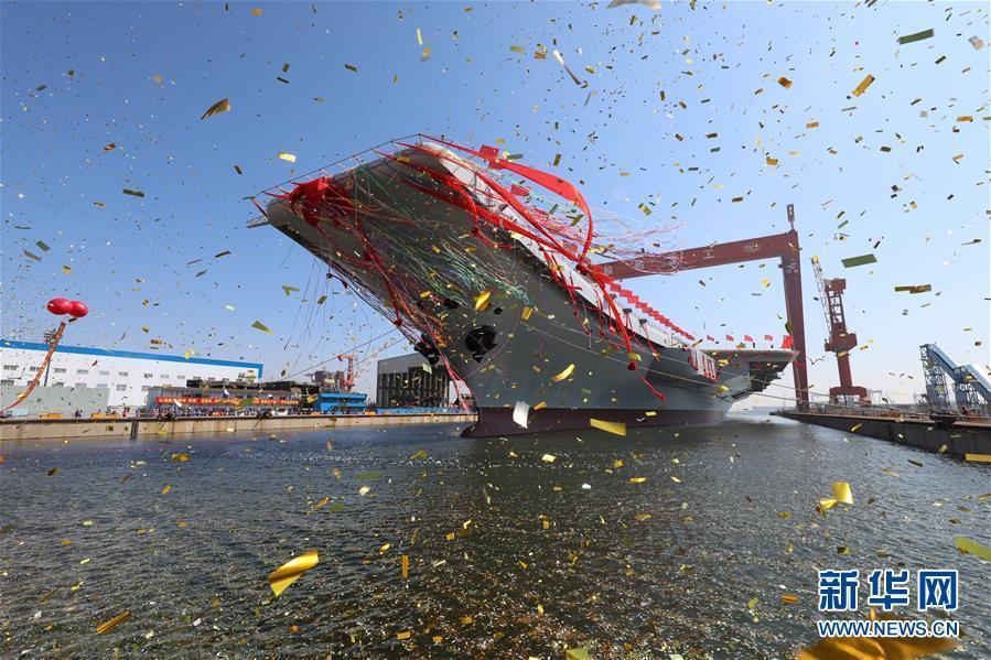 资料图:2017年4月26日,我国第二艘航空母舰下水仪式在中国船舶重工集团公司大连造船厂举行。图为航空母舰下水仪式现场。 新华社记者 李刚 摄 图片来源:新华网