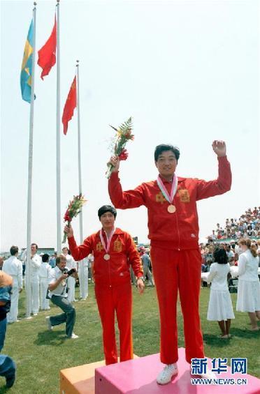 展现团结一致的拼搏精神――记我国首位奥运